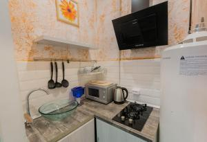 Кухня или мини-кухня в CityGroup Nevsky 53