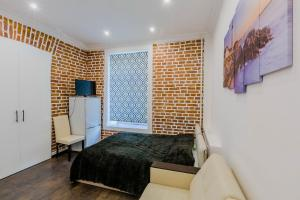 Кровать или кровати в номере CityGroup Nevsky 53