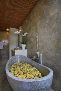 A bathroom at The Alena a Pramana Experience