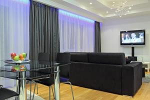 A seating area at The Queen Luxury Apartments - Villa Giada