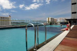 The swimming pool at or near Horizon Hotel