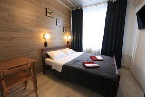 Кровать или кровати в номере Хостел Артист на Казанской