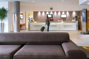 The lobby or reception area at Novotel Leuven Centrum