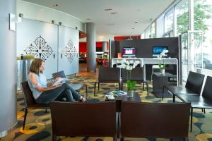 A restaurant or other place to eat at Novotel Leuven Centrum