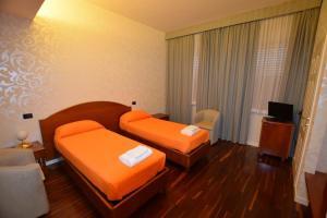 Letto o letti in una camera di Residenza Villa Duse