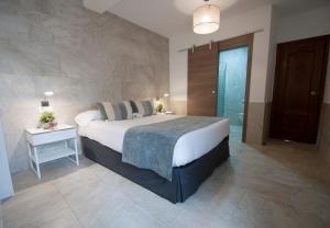 Cama o camas de una habitación en Hospedería Los Angeles