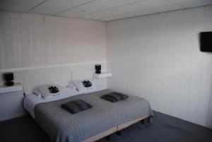 Een bed of bedden in een kamer bij Het Verschil