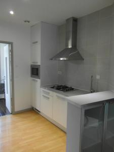 A kitchen or kitchenette at Garden in the city