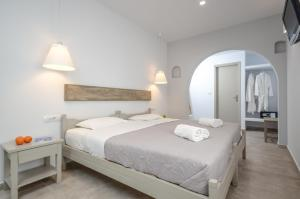 A bed or beds in a room at Argo Boutique Hotel