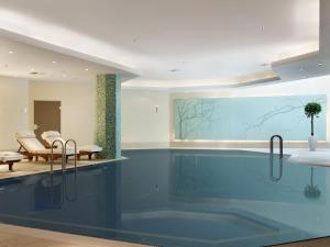 The swimming pool at or near Hilton Berlin