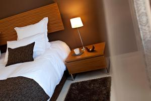 A bed or beds in a room at Le Mas de l'Espérance
