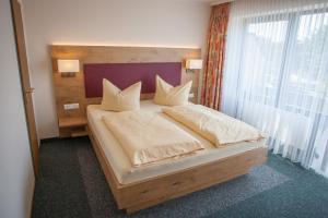 Ein Bett oder Betten in einem Zimmer der Unterkunft Ruser's Hotel