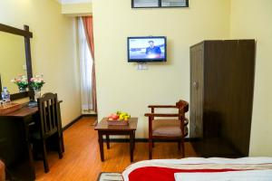 A television and/or entertainment center at Thamel Home