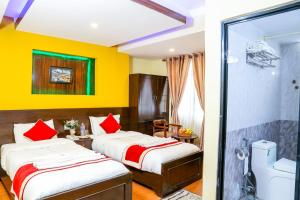 A bed or beds in a room at Thamel Home