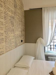 Un ou plusieurs lits dans un hébergement de l'établissement Hotel Domus Tiberina