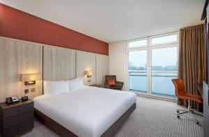A bed or beds in a room at DoubleTree By Hilton London Excel
