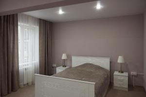 Кровать или кровати в номере Гостиница Аэропорт Емельяново