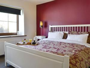 A bed or beds in a room at Oakridge Steading