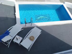 A view of the pool at Santorini Traditional Suites or nearby