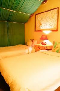 A bed or beds in a room at Da Fu Di B&B