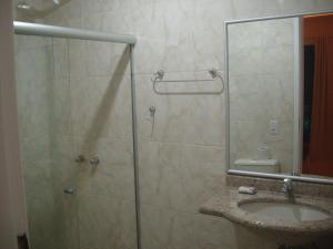 Um banheiro em Pousada Bon Vivant