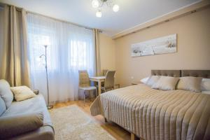 A bed or beds in a room at Savona Świnoujście