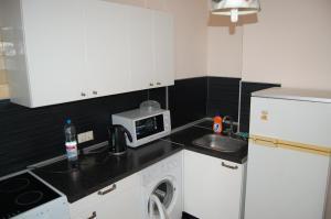Кухня или мини-кухня в Smart Apartment