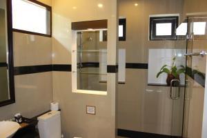 A bathroom at Leelawadee Garden Resort