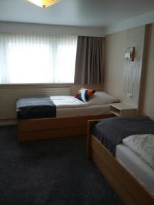Ein Bett oder Betten in einem Zimmer der Unterkunft Haus Marquet