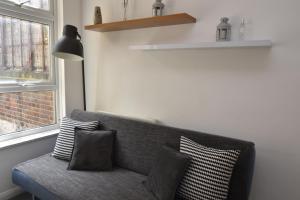 Coin salon dans l'établissement Cozy Apartment in Camden Town