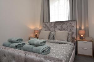 Un ou plusieurs lits dans un hébergement de l'établissement Cozy Apartment in Camden Town