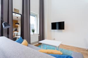 Un pat sau paturi într-o cameră la ApartDirect Hammarby Sjöstad
