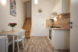 A kitchen or kitchenette at Family Duplex on Wenceslas square