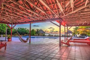 The swimming pool at or near St. George's Caye Resort