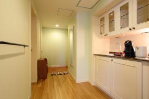 A kitchen or kitchenette at Namba Oriental Hotel