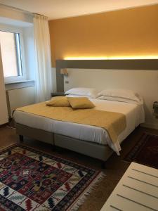 Letto o letti in una camera di Hotel Centrale