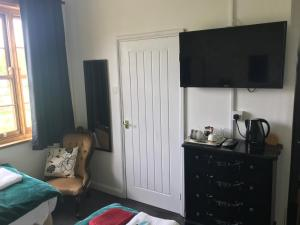 A television and/or entertainment center at Englands Rose