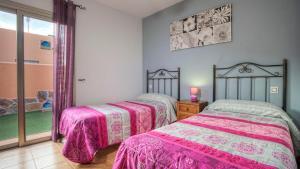 Łóżko lub łóżka w pokoju w obiekcie Villa Romana Golf Resort
