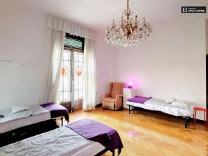 A bed or beds in a room at City Center Best Hostel