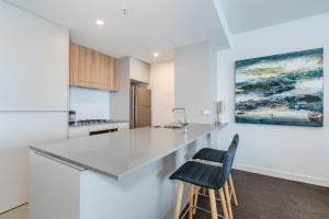 A kitchen or kitchenette at Arena, Unit A1205/75 Shortland Esplanade