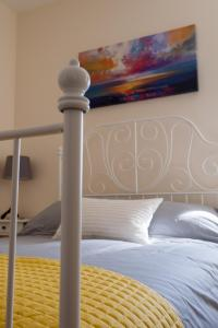 A bed or beds in a room at Ben Nevis View