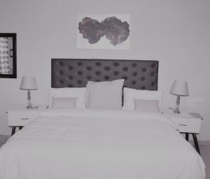 A bed or beds in a room at Sapphire Court