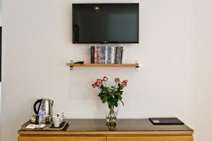 A television and/or entertainment center at The Cedars Bed & Breakfast