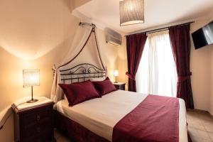 Ένα ή περισσότερα κρεβάτια σε δωμάτιο στο Ξενοδοχείο Αγκίστρι