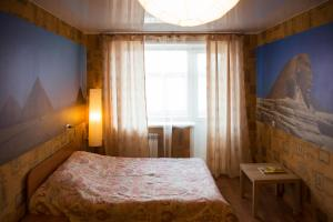 A bed or beds in a room at Apartment on Moskovskaya 4A