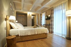 Letto o letti in una camera di Relais Villa Miraglia