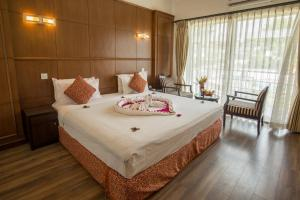 A bed or beds in a room at Waterfront Resort by KGH Group
