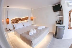 Un ou plusieurs lits dans un hébergement de l'établissement Villa Elina suites and more