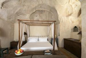 Letto o letti in una camera di Locanda Di San Martino Hotel & Thermae Romanae