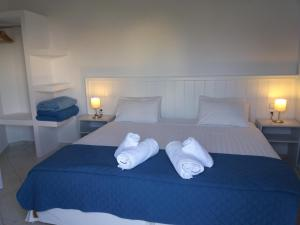 A bed or beds in a room at Naiades Almiros River Hotel